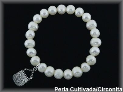 Pulseras  perla cultivada 7-8 mm col.bolso circonitas,elásticas.